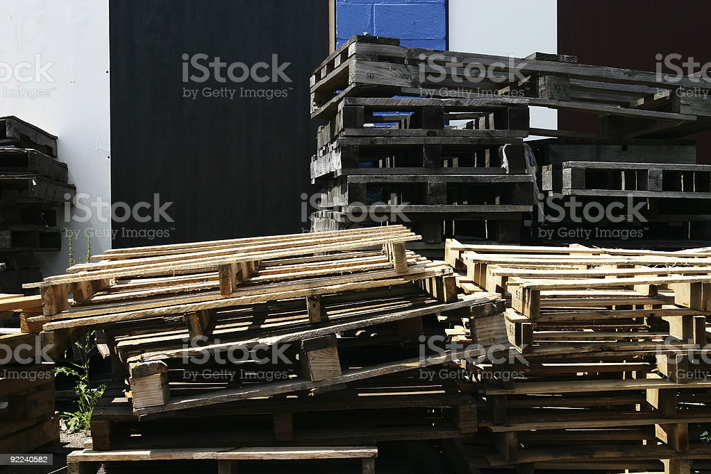 Pile of pallets by building royalty-free stock photo