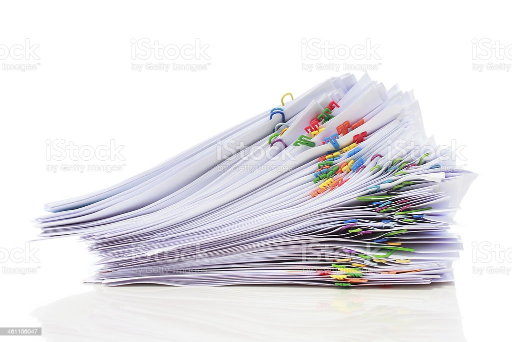 Pile of paper with colorful clips stock photo