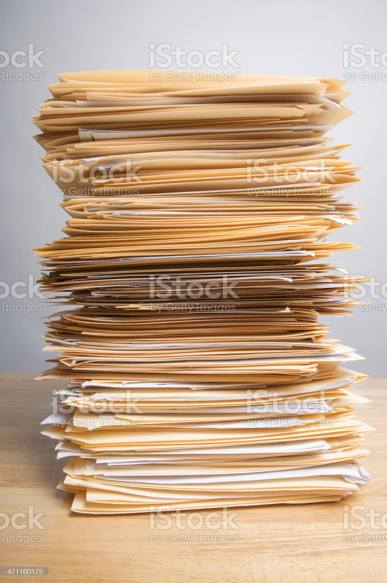 Pile of Paperwork on Wood Desk royalty-free stock photo