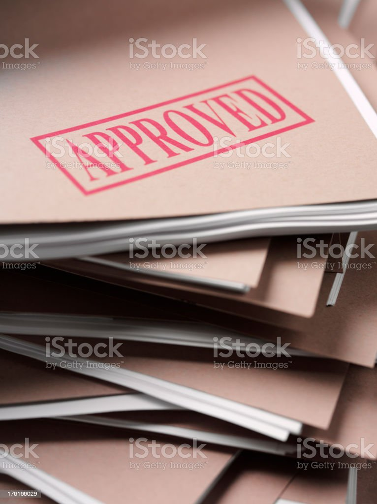 Pile of Paperwork with Approved Stamp royalty-free stock photo
