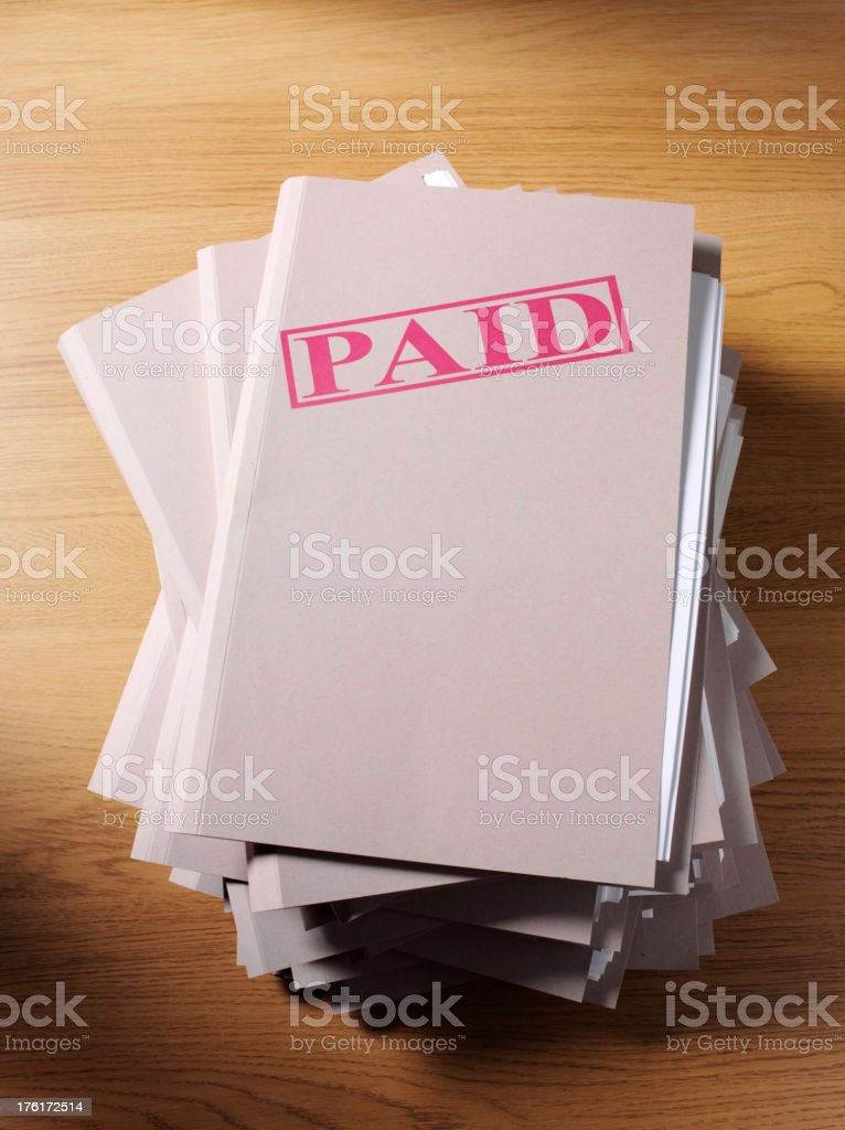 Pile of Paperwork with Paid Stamp royalty-free stock photo