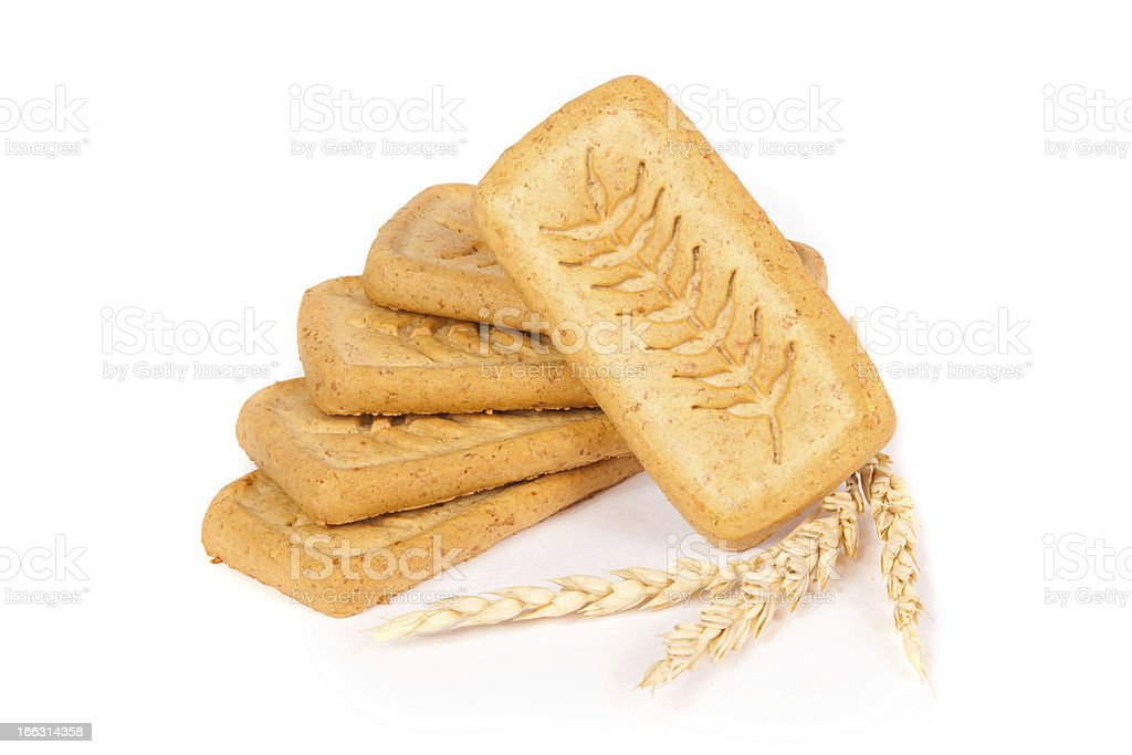 pile of pastry cookies with wheat isolated on white background royalty-free stock photo
