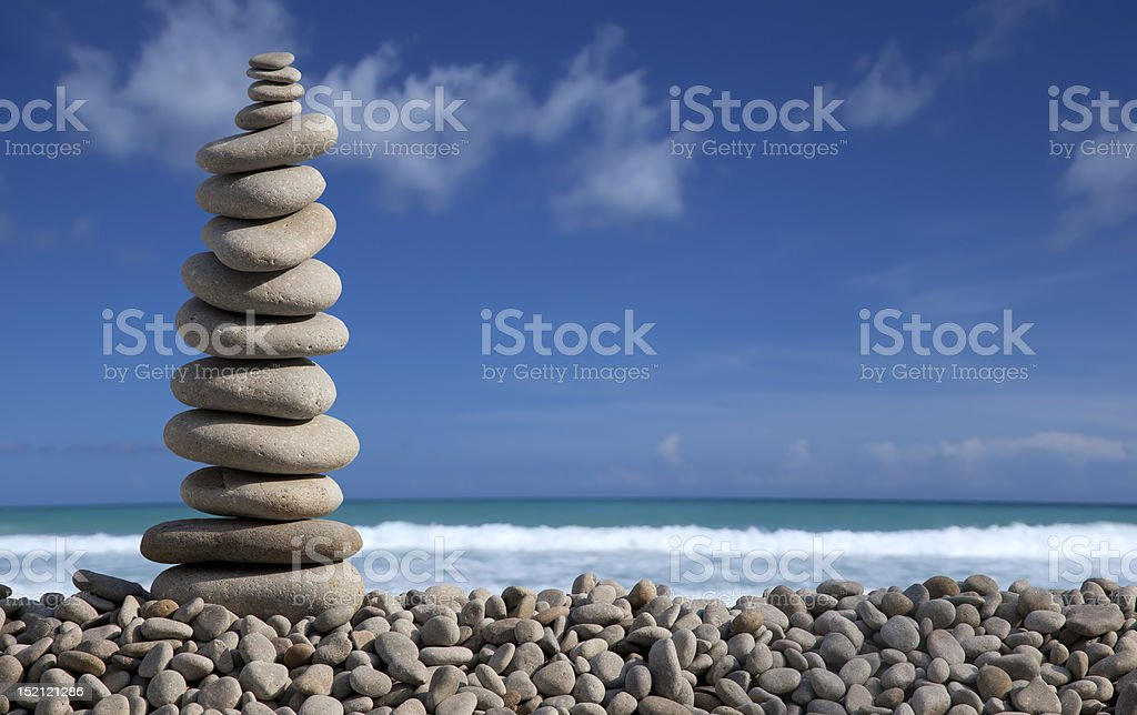 Pile of pebble Stones over blue sky and sea stock photo