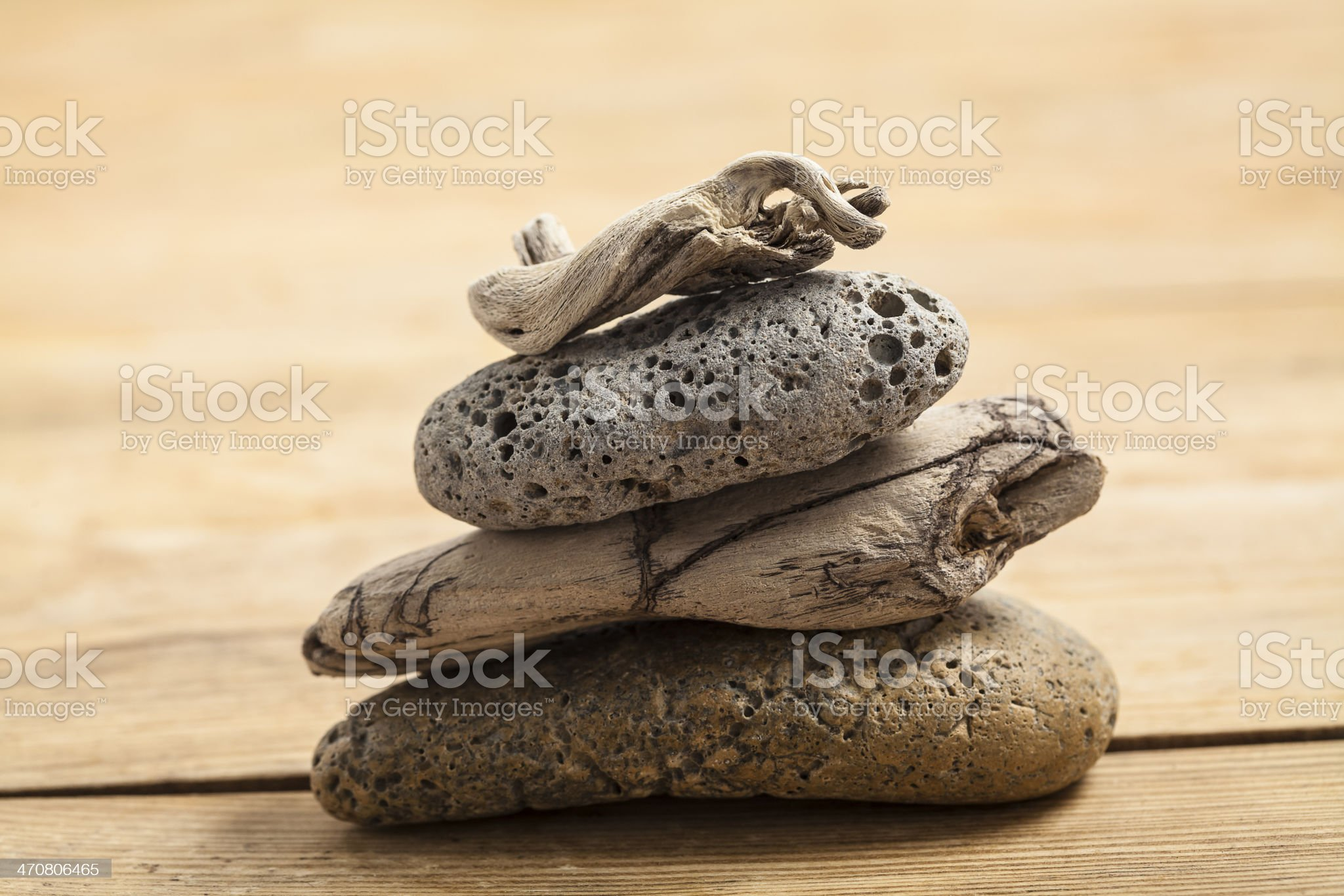 pile of pebbles and driftwoods royalty-free stock photo