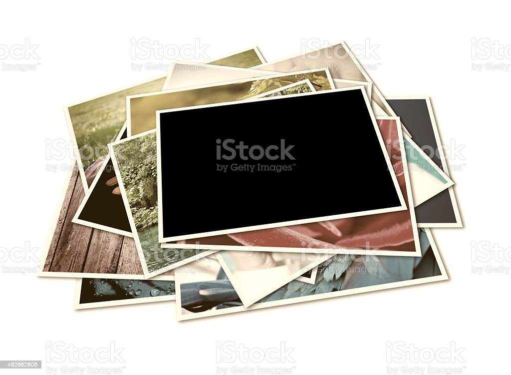 Pile of photographs with space for your logo or text. stock photo
