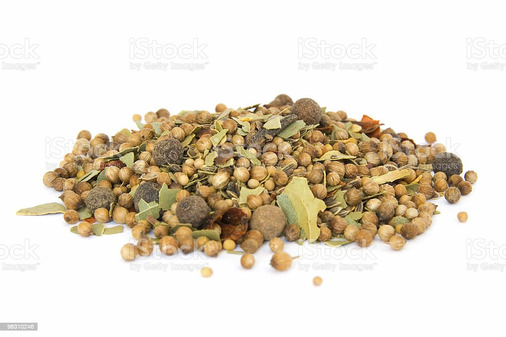 Pile of pickling spice on white royalty-free stock photo