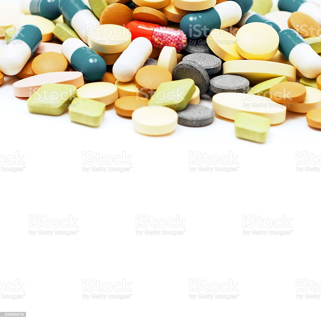 Pile of pills isolated on white background stock photo
