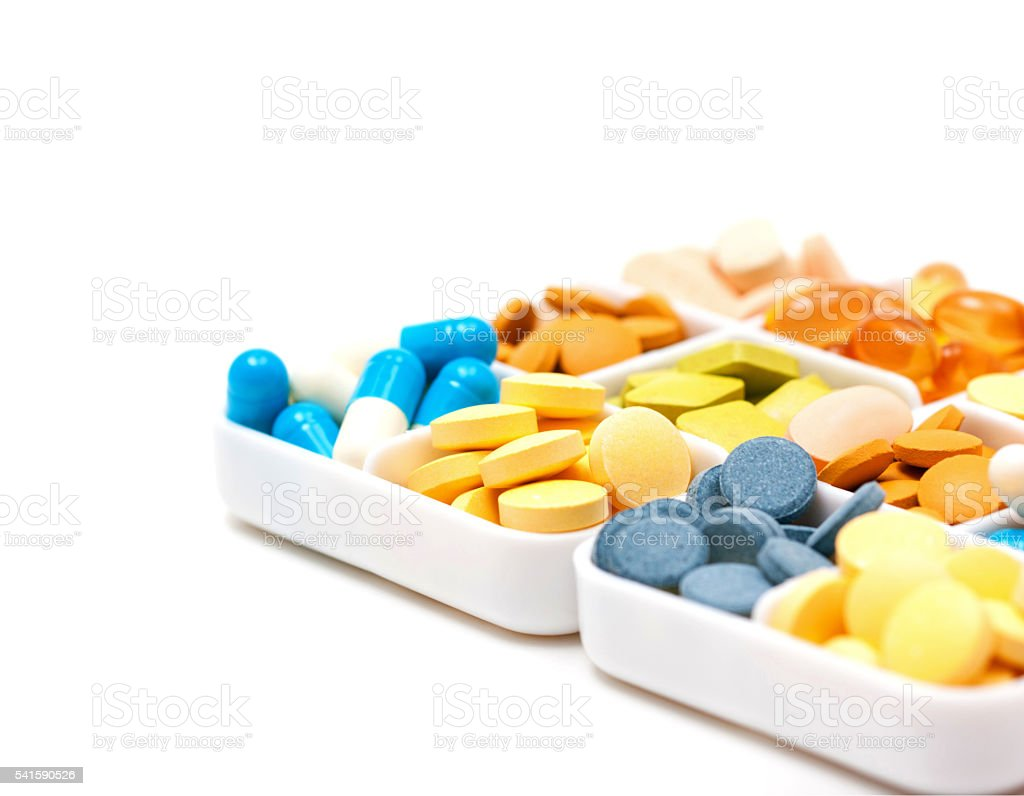 Pile of pills (medicine and health) isolated on white background stock photo
