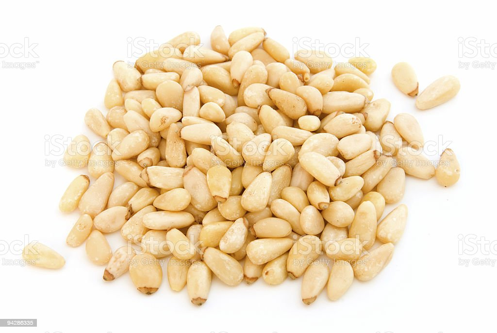 Pile of pine nuts on white royalty-free stock photo