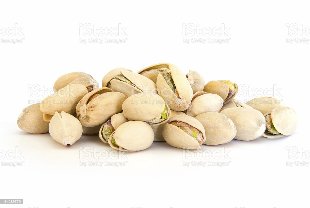 Pile of pistachios in shells on white royalty-free stock photo