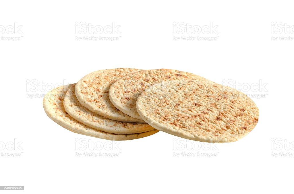 pile of pita bread on a white background stock photo