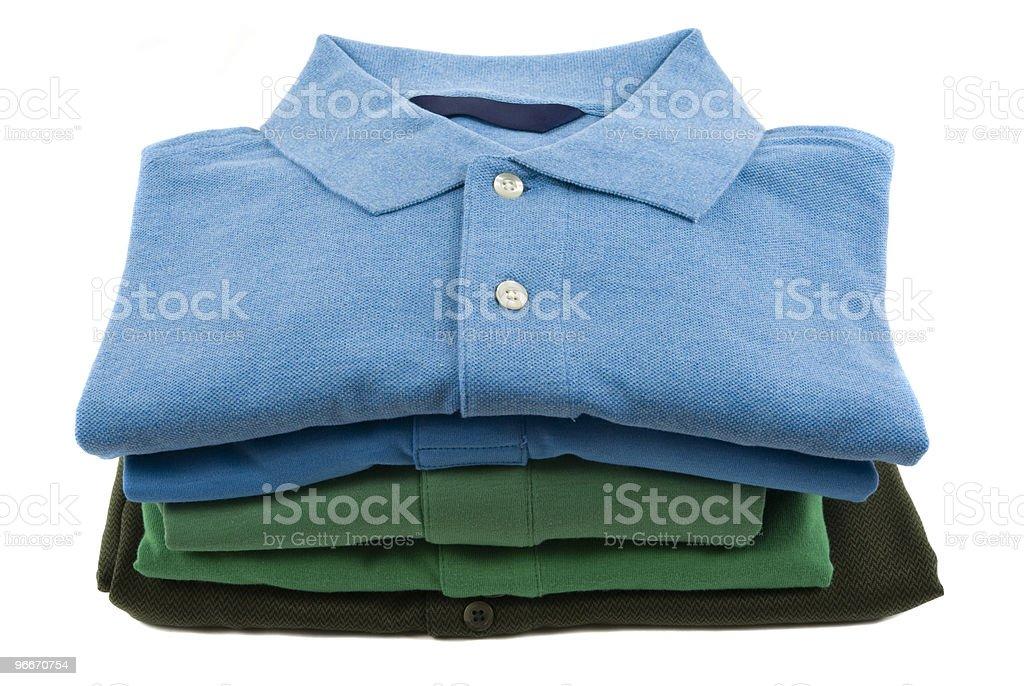 Pile of polo shirts folded neatly royalty-free stock photo
