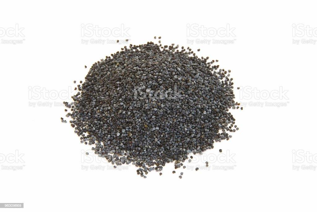 Pile of poppy seeds on white royalty-free stock photo