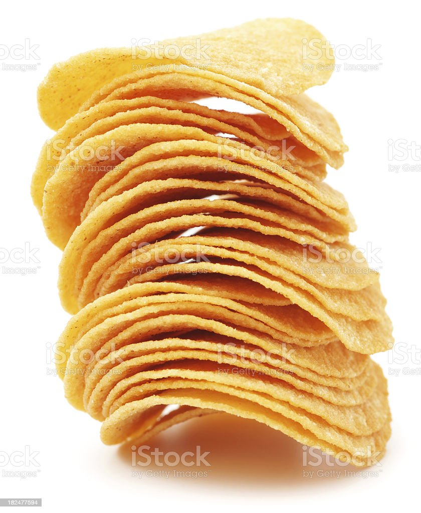 Pile of potato chips isolated on white royalty-free stock photo