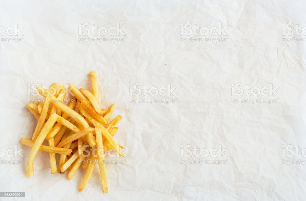 Pile of potato fries on kraft paper stock photo