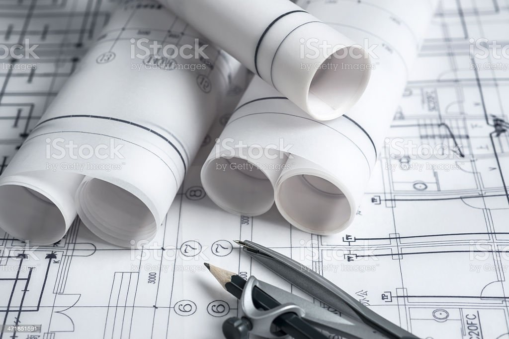 A pile of professional blueprints on the desk stock photo