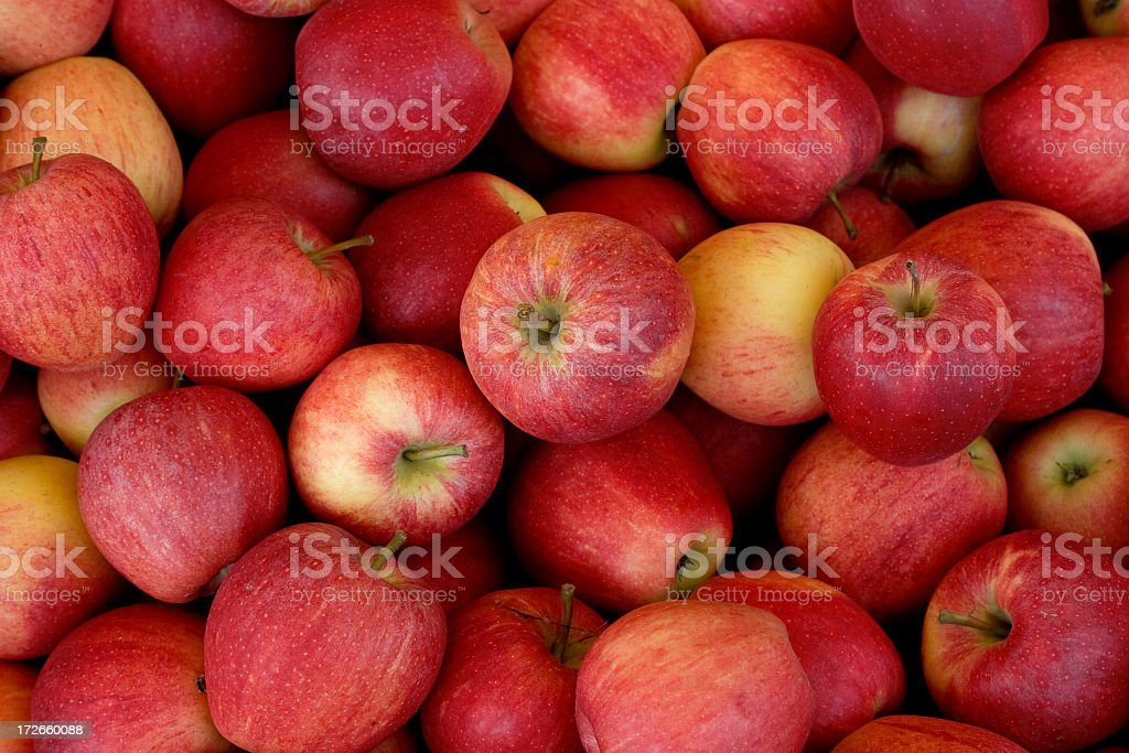 Pile of red and yellow apples background stock photo