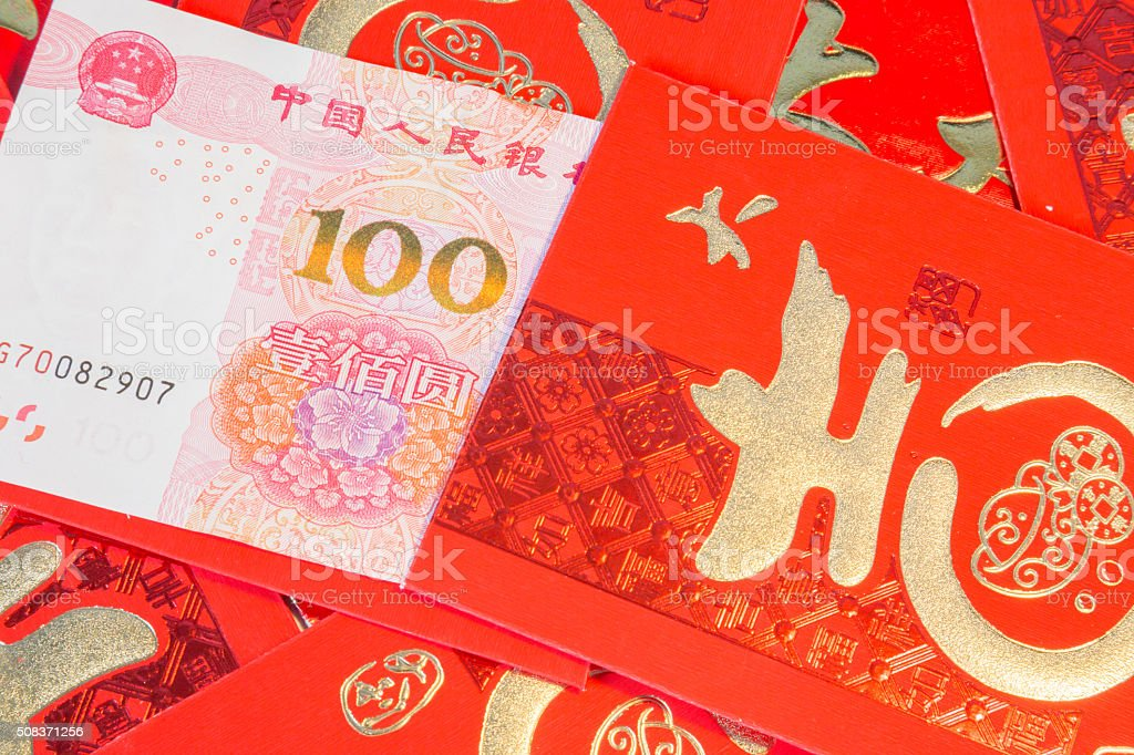 Pile of red chinese envelopes with money stock photo