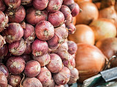 Pile of red onions at fresh market in Thailand