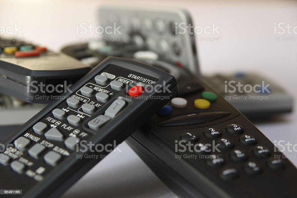 Pile of remote controls stock photo