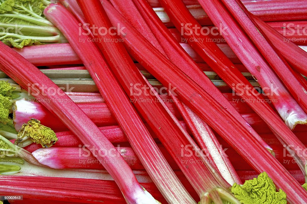 A pile of Rhubarb stalks with leaves on top stock photo