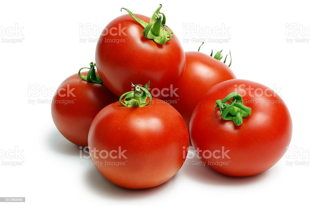 A pile of ripe red tomatoes on a white background stock photo