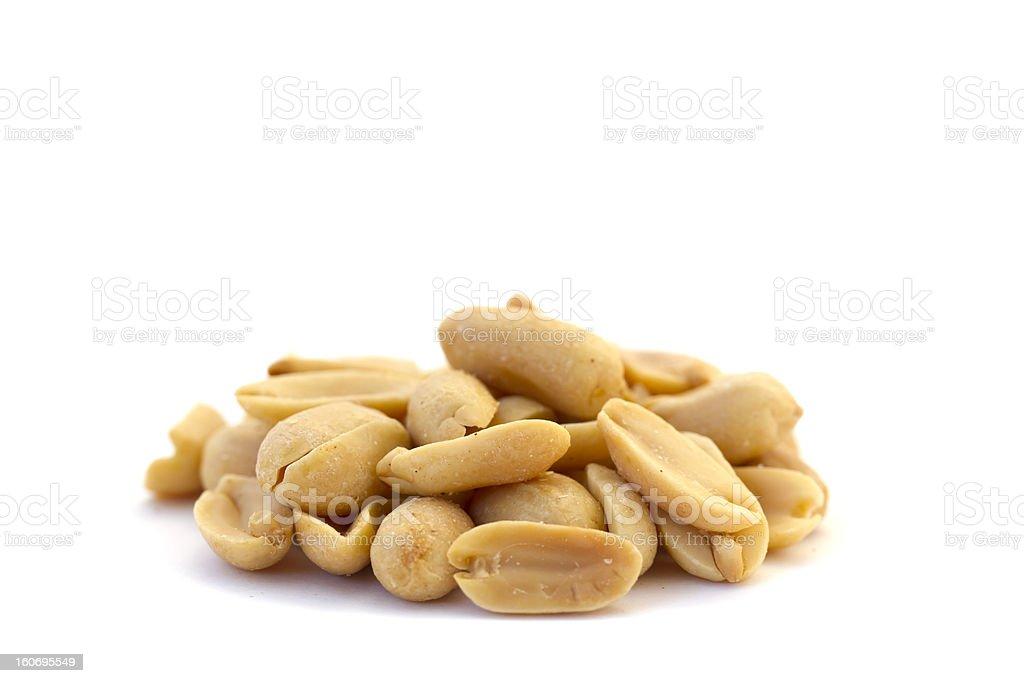 Pile of roasted peanuts isolated on white background stock photo
