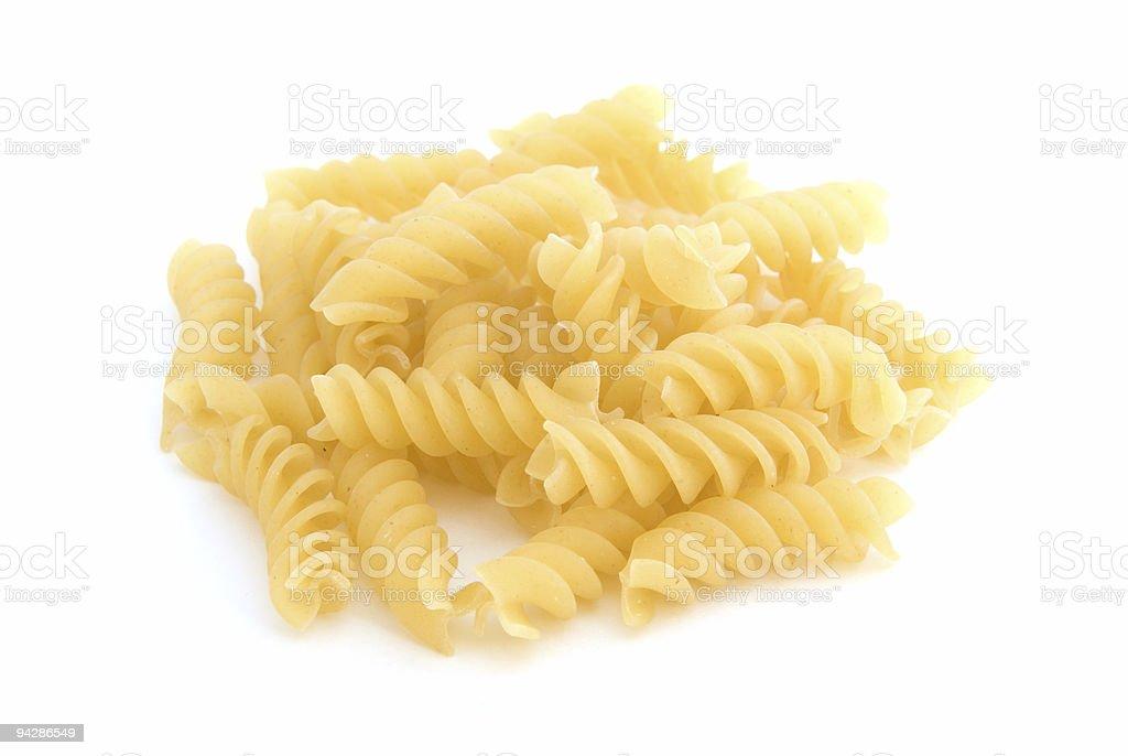 Pile of rotini pasta on white stock photo