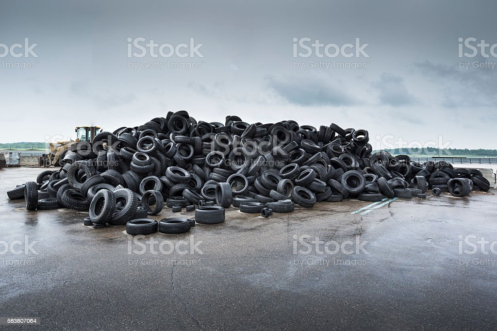 Pile of rubber car tires stock photo