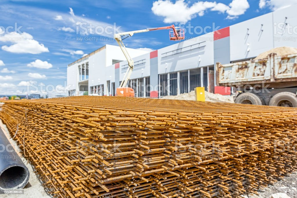 Pile of rusty quadratic reinforcing mesh, armature stacked temporarily stock photo