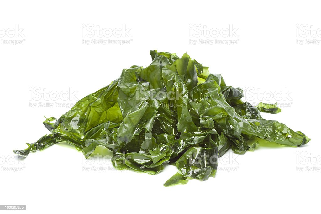 A pile of salted seaweed on a white background stock photo