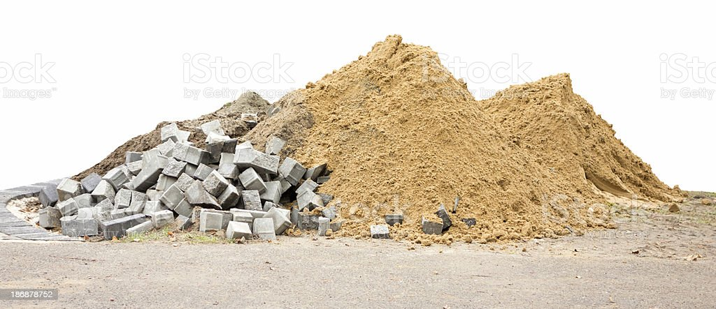 pile of sand and stones isolated white background stock photo