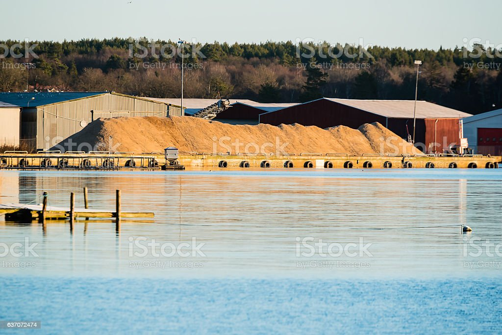 Pile of sand in harbor stock photo