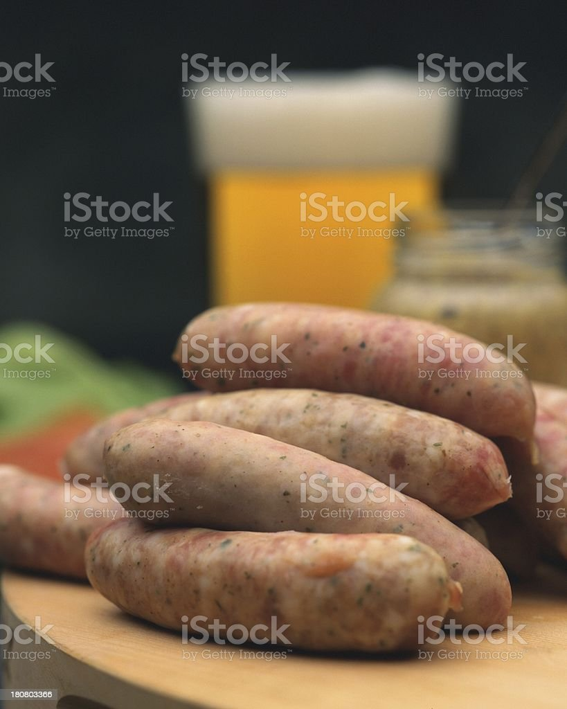 pile of sausages with beer royalty-free stock photo