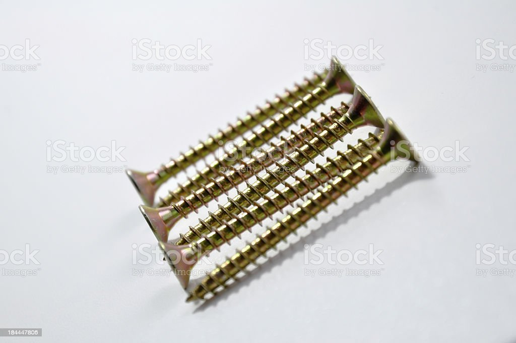 pile of screws on white background stock photo