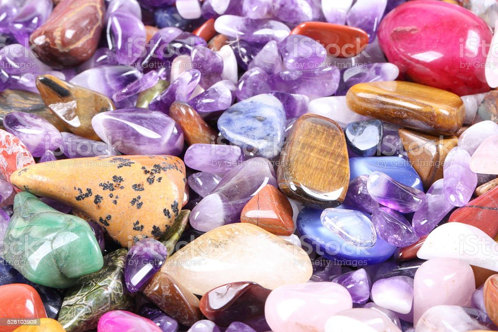 pile of semi precious jewelery stones closeup stock photo