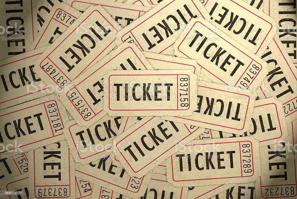 A pile of several white, black and red ticket stubs stock photo