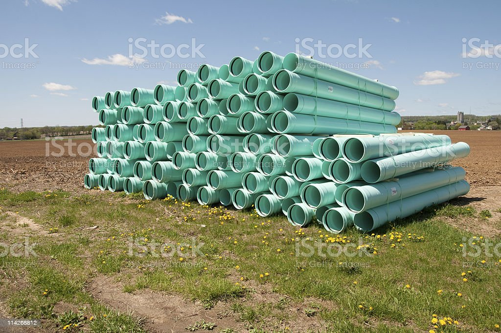 pile of sewer piping stock photo