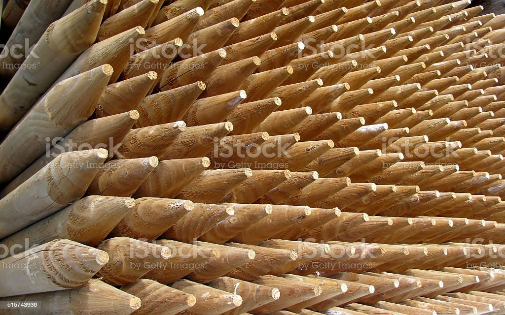 Pile of sharpened fence posts stock photo