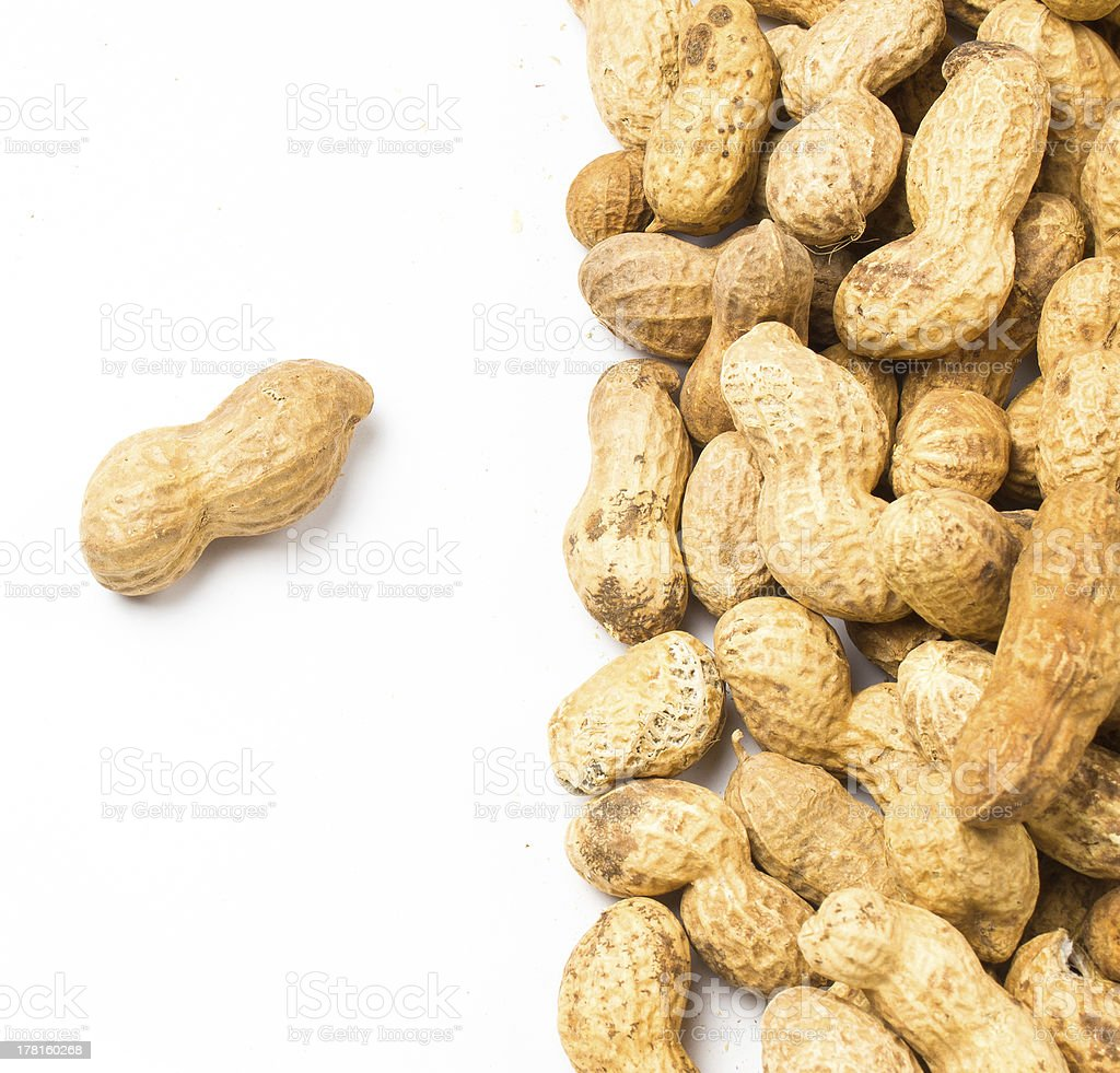 pile of shelled big peanuts closeup on white background royalty-free stock photo
