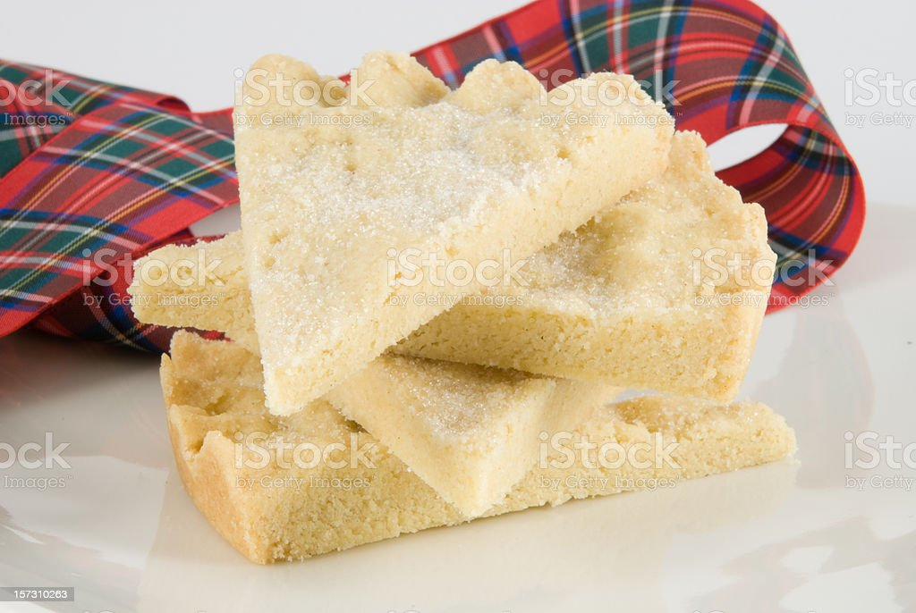 pile of shortbread with red tartan ribbon stock photo