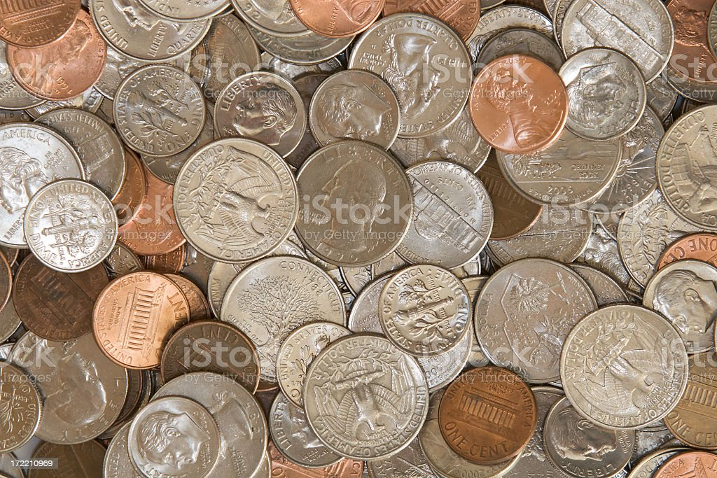 A pile of silver and copper coins stock photo