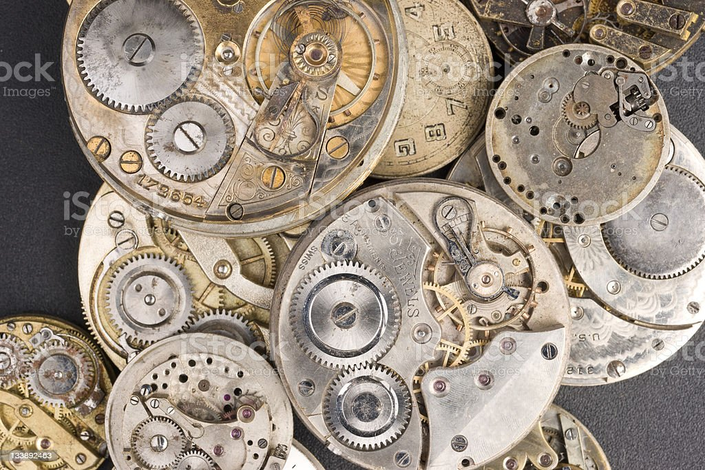 Pile of Silver and Gold Watches in Various Unassembled States royalty-free stock photo