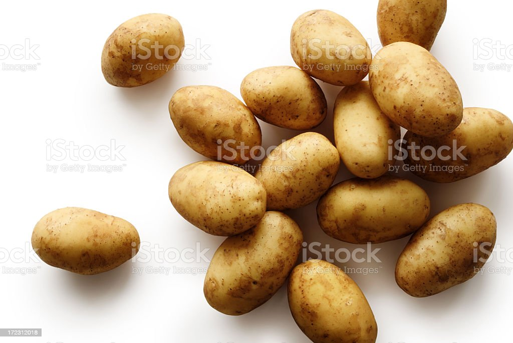 Pile of small baby potatoes on a white background stock photo