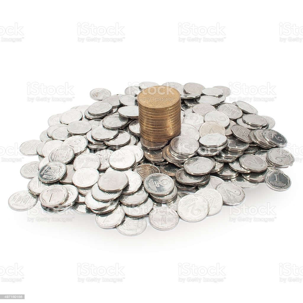pile of small coins and a column of the hryvnia stock photo
