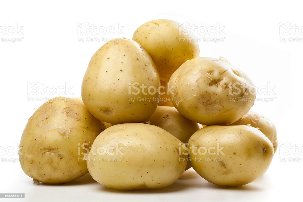 A pile of small yellow potatoes royalty-free stock photo