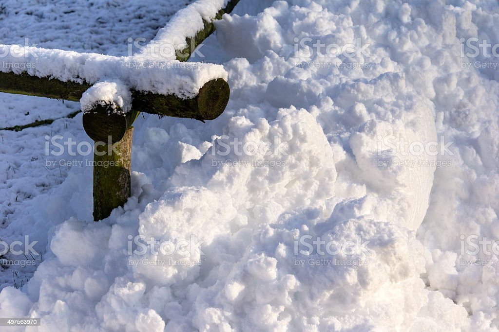 Pile of Snow at a Fence stock photo
