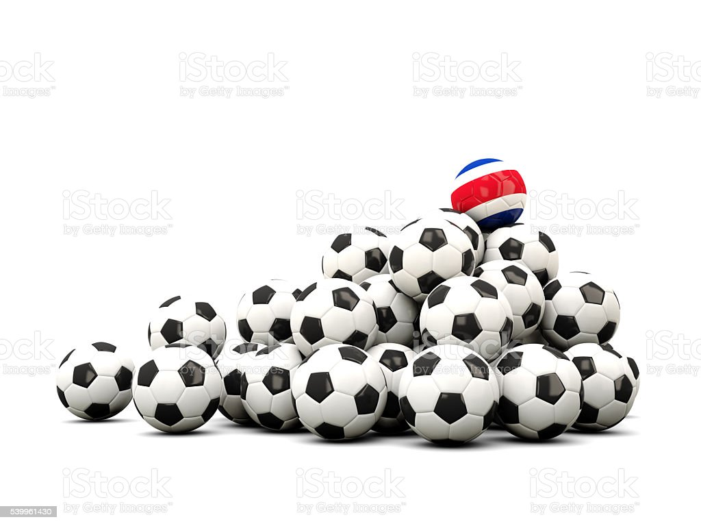 Pile of soccer balls with flag of costa rica stock photo