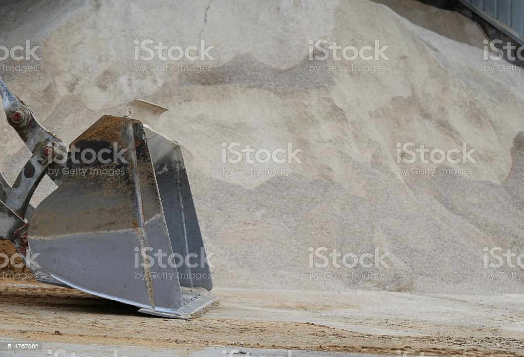 Pile of Soil and Loader Rock Bucket stock photo