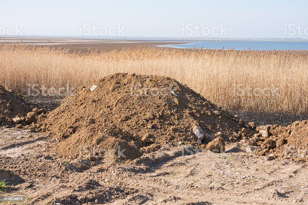 Pile of soil intended for sleep swamp stock photo